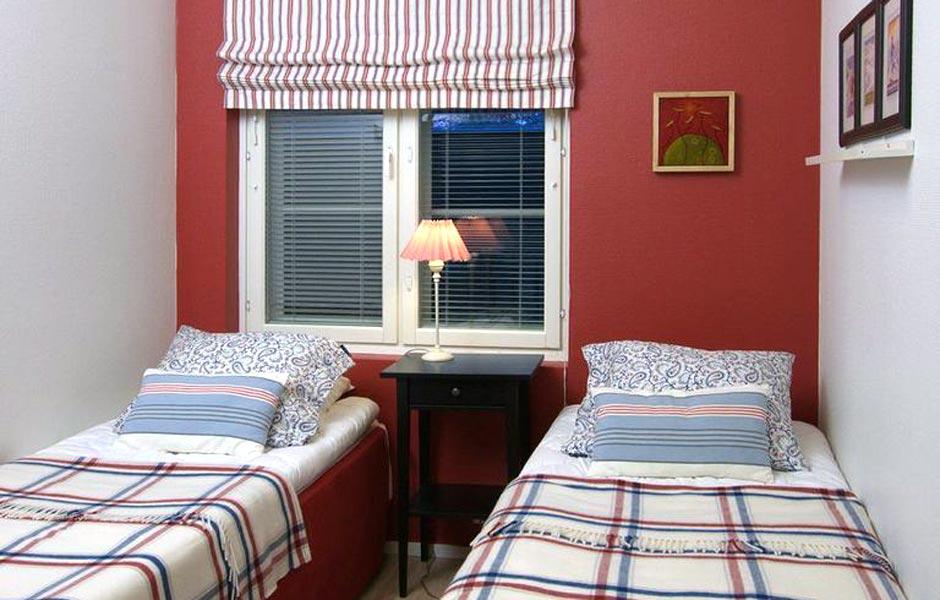 Levin lumienkeli Alppihuoneisto B3 punainen makuuhuone; Levi Snowangel B3